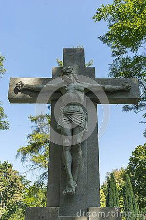 Monuments Christ on the cross on the Tomb in Rakowicki cemetary in Krakow.
