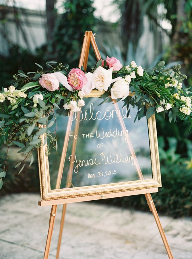 Pretty glass wedding sign: http://www.stylemepretty.com/2016/04/12/the-prettiest-pink-brunch-wedding/ | Photography: Gianny Campos - http://www.giannycampos.com/