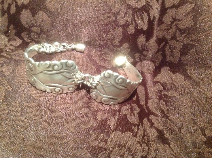 Bracelet, made from two unusual silver plate spoon handles, joined with chain links and a magnetic clasp.