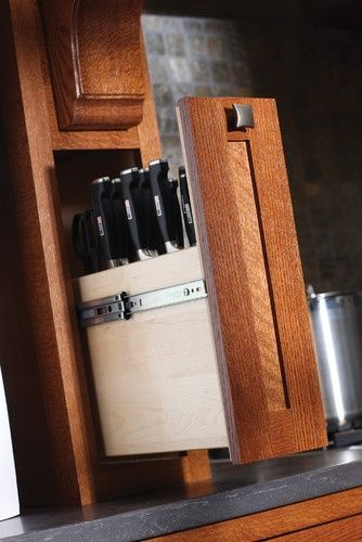 Clever storage for knives... create drawer in butcher block table.