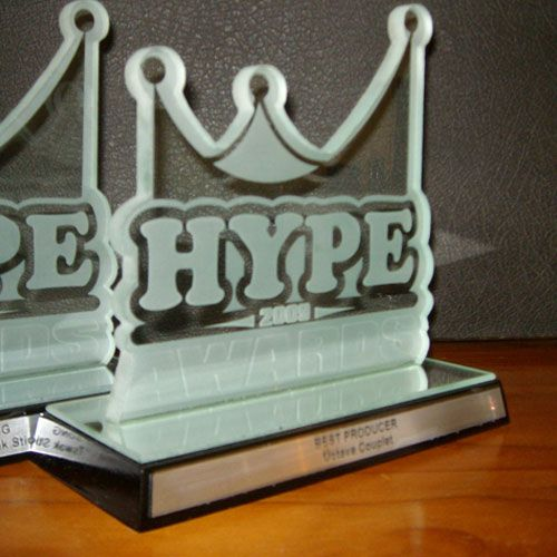 Sandblasted custom glass award - Hype Awards - with silver romark plate.