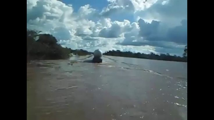 Trucker penetrate the flooded road