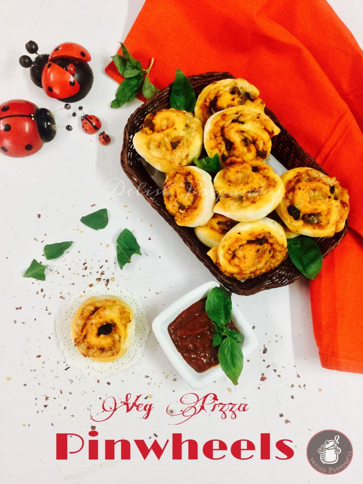 Veg Pizza Pinwheels Who would not love mini pizzas in bite sizes filled with gooey mozzarella, pizza sauce and veggies. These chewy ,cheesy spirals are perfect as an appetiser for a family gathering or a party.