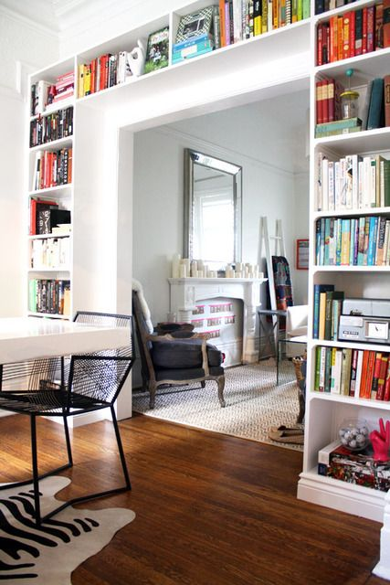 If the room has tall ceilings, I'd love to have bookshelves that wrap around the doors