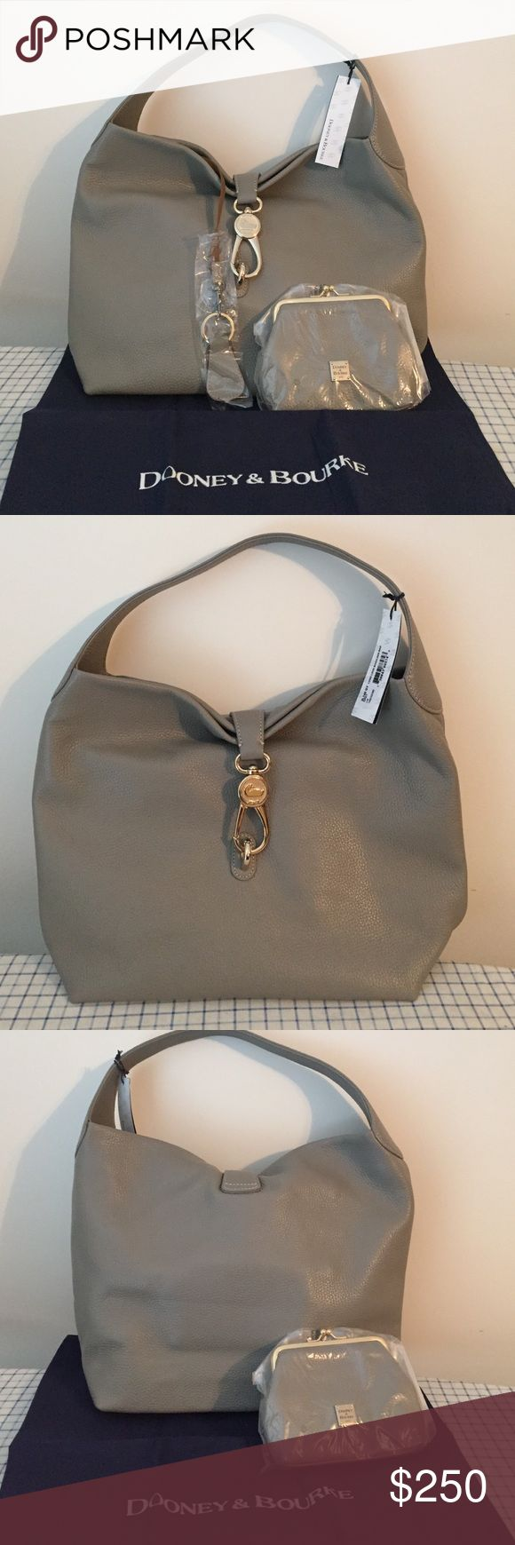 """Dooney & Bourke Logo Lock Shoulder Bag Includes hobo, matching coin purse with kiss lock closure, and key fob Contrast stitching, reversible goldtone hardware lock closure, four metal feet Full signature red check interior lining, three front-wall slip pockets (one with a button tab closure), back-wall zip pocket, coin purse pocket, and dog leash-style key clip Approximate measurements: Hobo 17""""W x 12""""H x 5""""D with an 8"""" strap drop; weighs 2 lbs, 4 oz; Coin purse 6""""W x 5""""H x 1""""D Dooney…"""