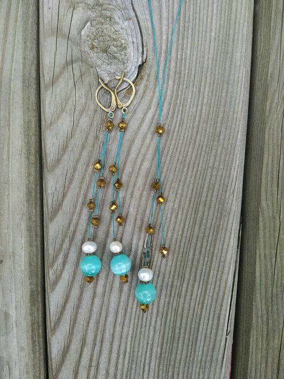 Conjunto collar y pendientes perlas y ojo de gato