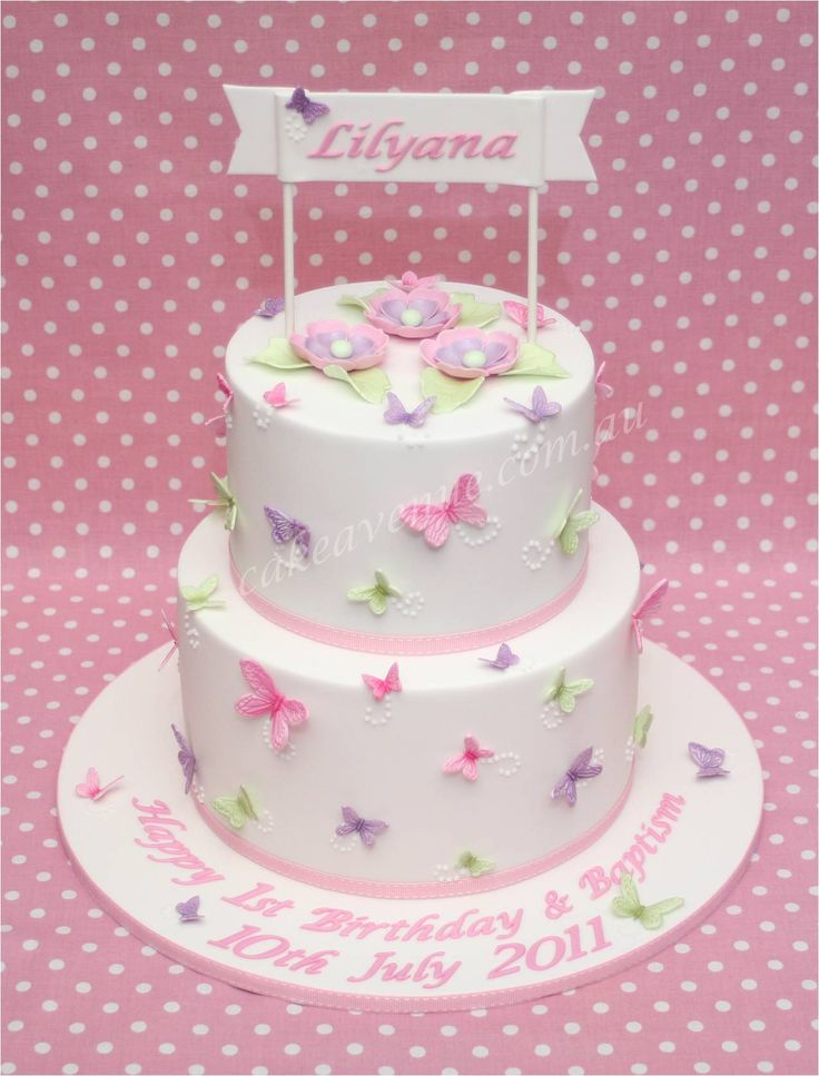 Pastel Butterfly Cake with edible butterflies and flowers for a joint Christening and Birthday party.