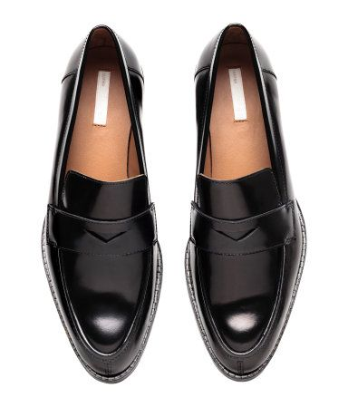 Black. PREMIUM QUALITY. Leather loafers with pointed toes and a tab across front. Leather lining, leather insoles, and rubber soles. Heel height 1 1/2 in.