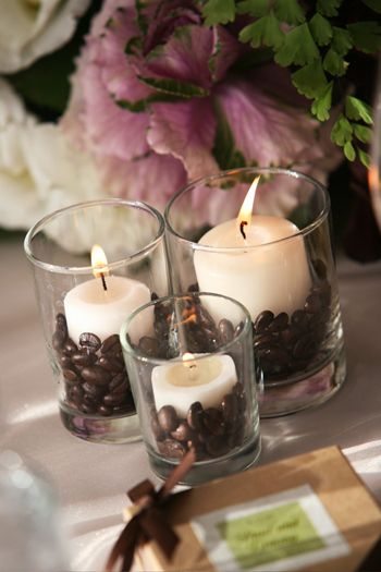 Snug a candle into coffee beans…light and enjoy!  I have done this and I used a vanilla scented candle with the coffee beans and all I can say is WOW! Love this Idea over at The Brides Cafe!