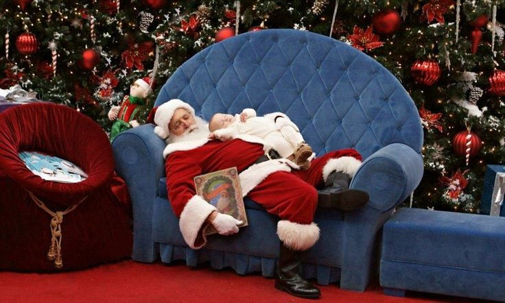 Santa's baby: Adorable picture of mall Santa lulling a fussy newborn back to sleep