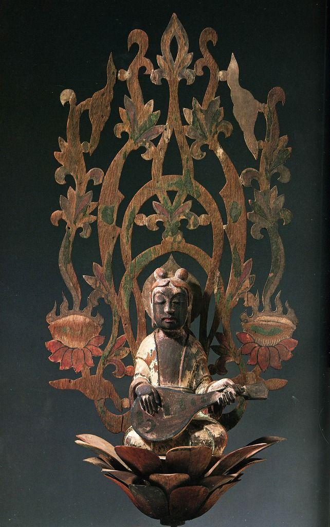 奈良 法隆寺 天蓋飛天 TENNIN (Apsaras) -- Celestial Beings Tennin playing the Japanese mandolin (biwa 琵琶) Wood, Height = 49.2 cm, Asuka Era, 7th Century Attached to the canopy in the Kondō Main Hall at Hōryūji (Horyuji) Temple 法隆寺 in Nara.