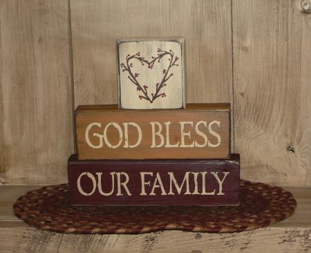 HANDMADE~ I have hand painted thisprimitive wood God Bless Our Family stackingblock set. They are nice shelf sitter setto add into yourCountry Primitivehome decor. They are painted with black underneath and then topcoated withivory, mustard and burgundy. I have then distressed them for more of a rustic primitive look. Nice accent for you primitive countryhome decor.   Measures  approx 9 x 9 h