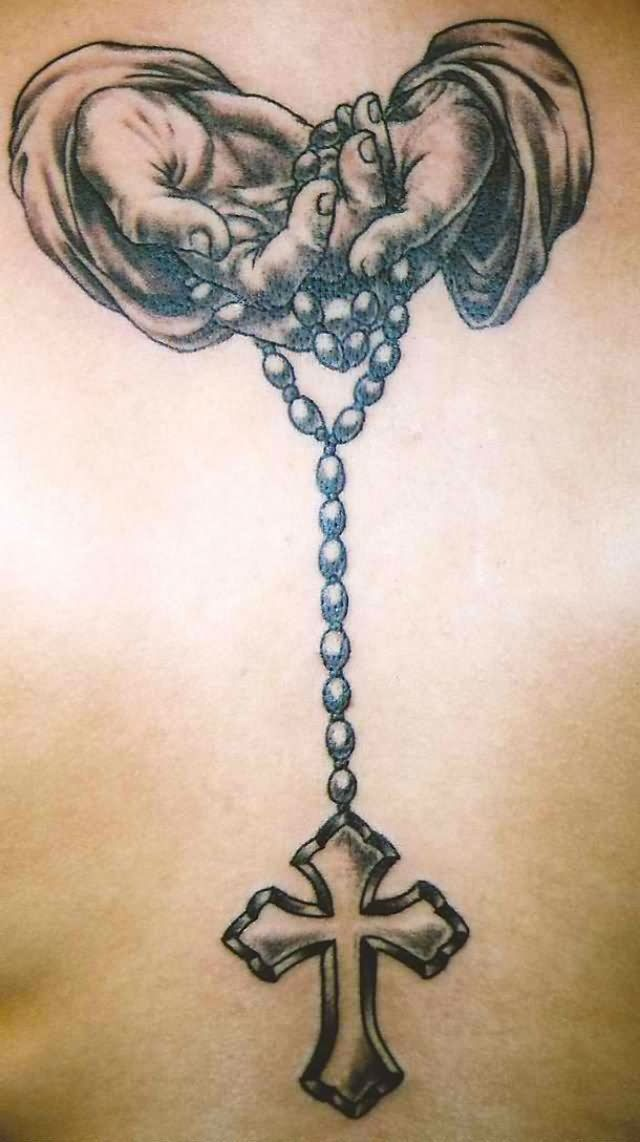 Open praying hands with rosary and cross tattoo by Slobula
