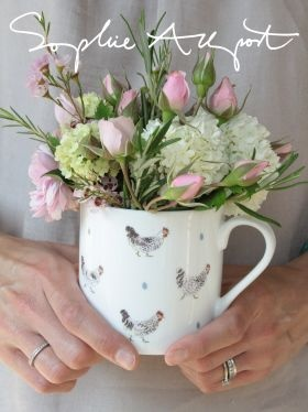 "Beautiful flower arrangement in ""Chicken & Egg"" Large China Mug by Sophie Allport."