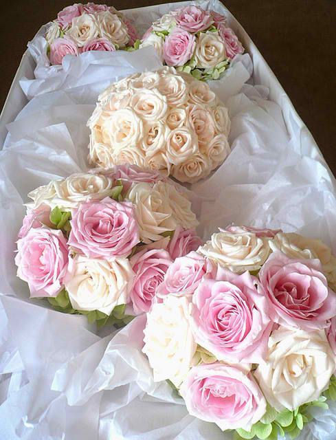 4 White and Pink Rose Bridesmaid Bouquets and 1 White or Ivory Rose Bridal Bouquet. $280.00, via Etsy.