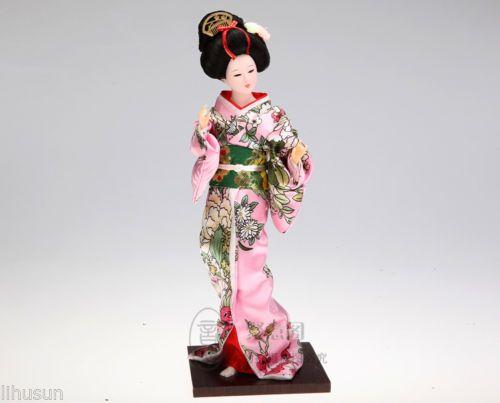 Barato Atacado de seda chinesa Handmade ornamento boneca figura do traje japonês, Compro Qualidade Bonecas diretamente de fornecedores da China:             Descrição                              Material: seda                              Tamanho: 13*32 cm