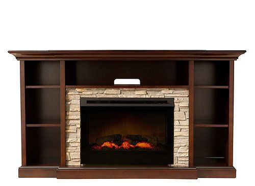 """If you love a fire's cozy ambiance but not the hassling prep work, try this Merrick 65"""" TV console with 25"""" electric fireplace to warm up your living space. Its realistic design and functionality features include hand-painted logs, pulsating embers with adjustable light and flames, a brick-look frame and an internal heating system. A remote control is included for easy operation, so you can enjoy the beauty and warmth of a fire with just the push of a button!"""