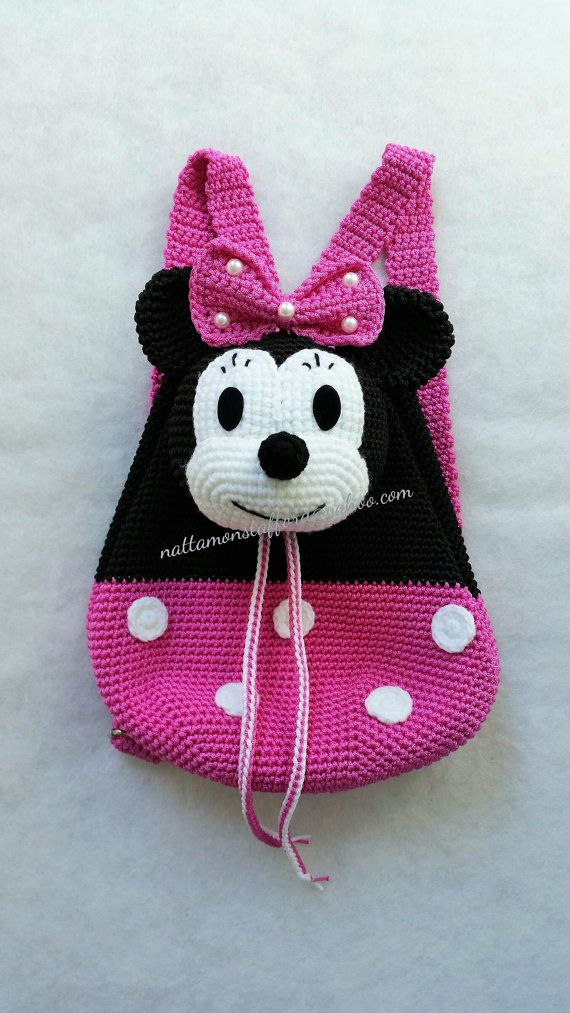 Soft Nylon Minnie Mouse crochet backpack gift that any child will love, its a very meaningful gift for your love one,perfect for all seasons of the year or holiday trip. The minnie mouse head is the flap of the backpack, roomy backpack will hold childrens  - This is a perfect present for every girls, Christmas gift, Birthday gift,mother gift , someone you love! - I have taken this photo myself. These bags are of the best quality that are carefully made of soft nylon by hands. - The color may…