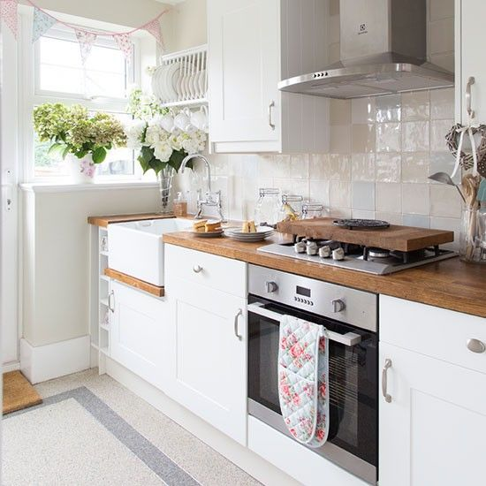 White country-style kitchen with oak worktop