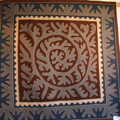 Shyrdak spiral design felted rug
