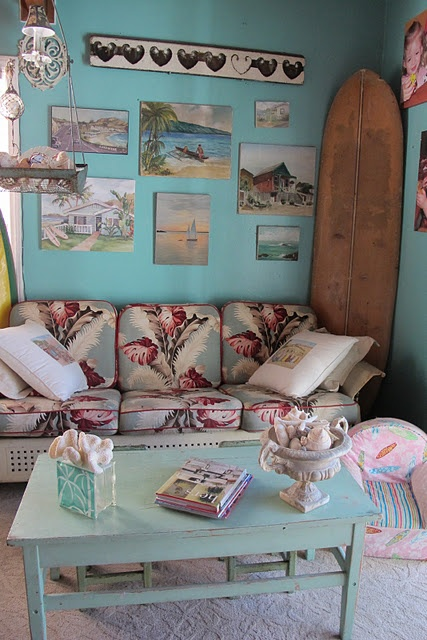 Bringing the outside in.  A glider bench comes into a beach-themed bedroom (from Country Roads Antiques)