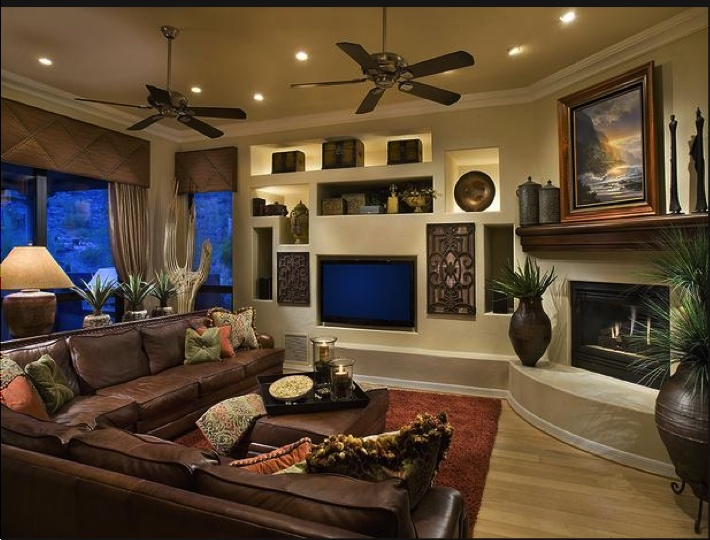 Large brown sectional and awesome built in wall unit living room