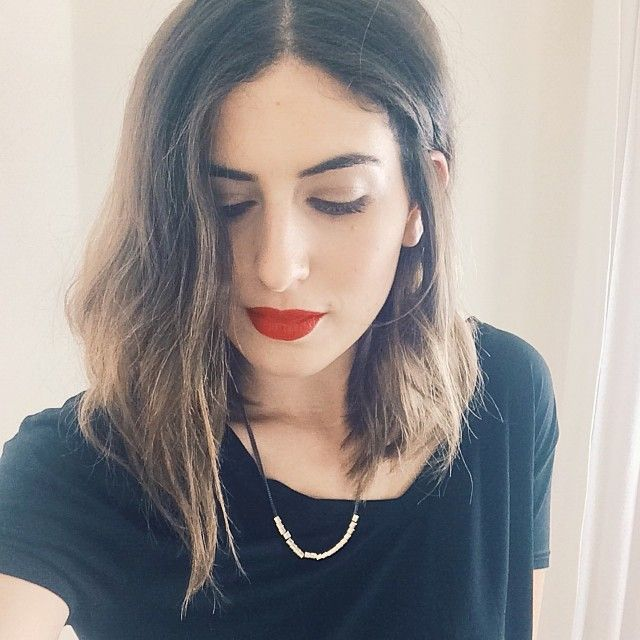 Matte red lips with simple base and wavy, sun-kissed hair on beauty blogger Lily Pebbles.
