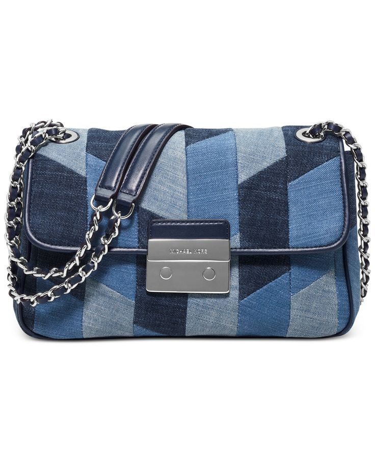 "A long chain-link strap you can wear crossbody or doubled at the shoulder gives this trendy denim patchwork bag a flash of chic style you can show off day or night. By MICHAEL Michael Kors. - 25""L cro"