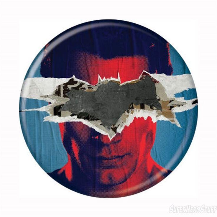 The 1.25 inch diameter Batman Vs Superman Superman Propaganda Button has an image of Superman with a Batman logo scrawled across his face! I suppose Batman felt like being cheeky!