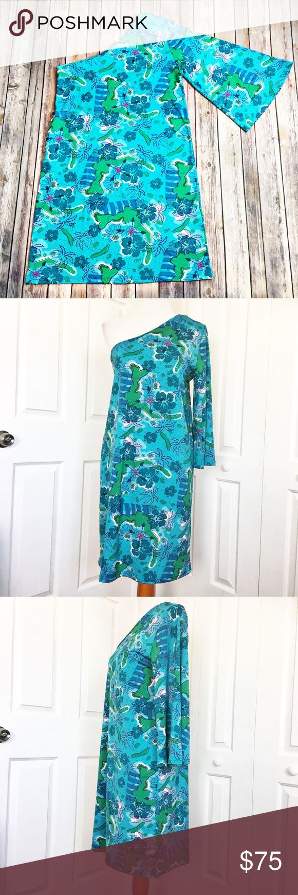 """Tracy Negoshian Dress Great dress by Tracy Negoshian.  Aqua in color with an all over lighthouse/floral print.  Has zippered side pocket with gold hardware. Material is 95% polyester and 5% elastane.  Measurements laid flat and unstretched: bust 18"""", waist 19 1/2"""", hip 21"""", and length from top of shoulder to hem 38 1/2"""".  EUC. Tracy Negoshian Dresses One Shoulder"""