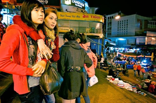 Lending a Shoulder, Dalat Night Market in Vietnam