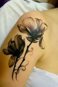Black and Gray Floral Tattoo on Upper Arm. 30+ Beautiful Flower Tattoo Designs.
