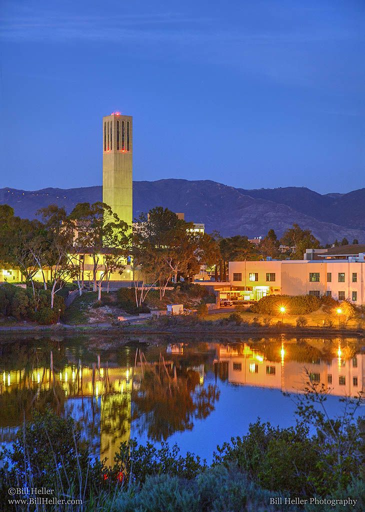 Storke Tower Lagoon Reflection - This view of Storke tower on the campus of UCSB is taken from the path around the lagoon by the residence halls. What an amazing view those halls must have. UCSB is an amazing place to be this time of evening. The combination of architecture, lighting and water makes for some breathtaking vistas.   http://www.BillHeller.com