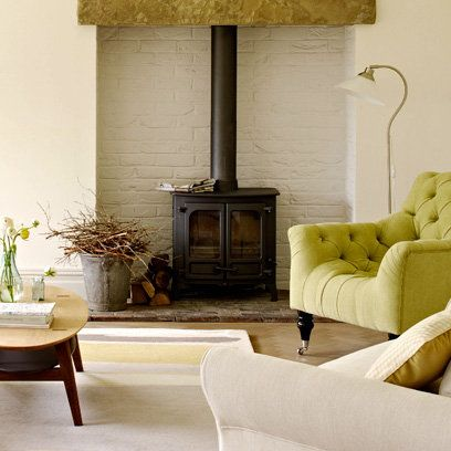 White brick walls, black fireplace stove - perfect since we're looking for a wood burner for the dining room!