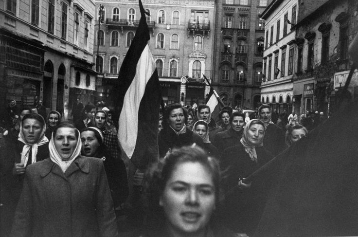 "A Rip in the Iron Curtain: Photos From the Hungarian Revolution, 1956 | LIFE.com...Caption from LIFE. ""Carrying flags of old Hungary and singing a patriotic song, Budapest women march in honor of men who died fighting communists."