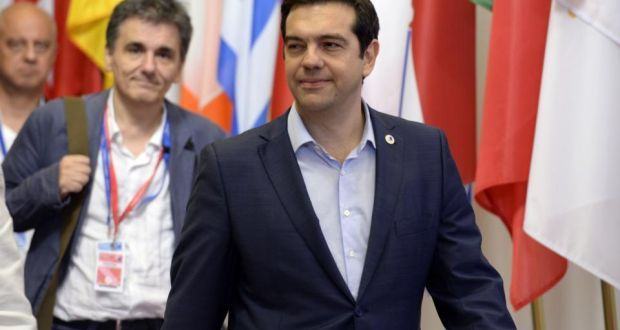 Brussels all-nighter.... Greek Prime Minister Alexis Tsipras (right)  and Finance Minister Euclide Tsakalotos leave at the end of the  euro zone summit on Monday.   Photograph:  Thierry Charlier/AFP/Getty Images
