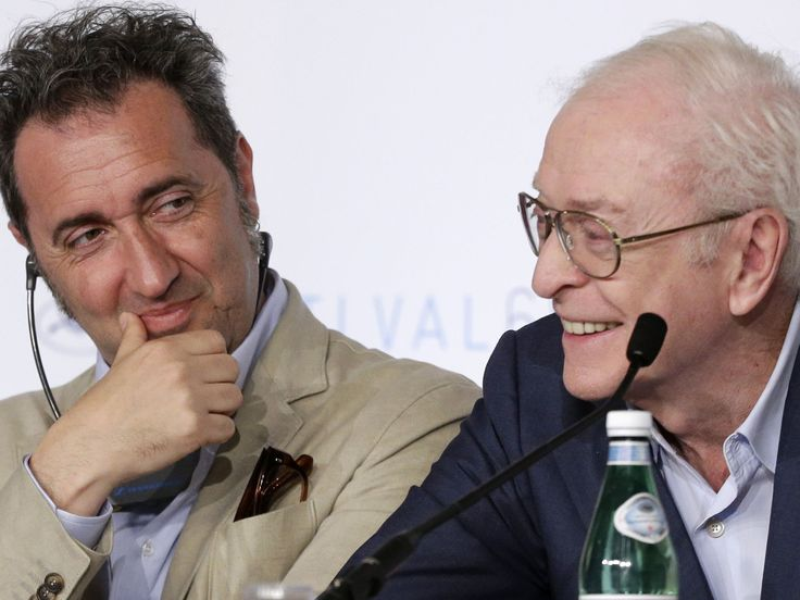 """Director Paolo Sorrentino, left, smiles as actor Michael Caine speaks during a press conference for the film """"Youth"""" in Cannes. Thibault Camus, AP"""