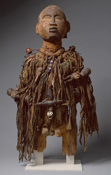 Power Figure (Nkisi), 19th-20th century, DRC. Wood, paint, nails, cloth, beads, shells, arrows, leather, nuts, twine.  Metropolitan Museum of Art