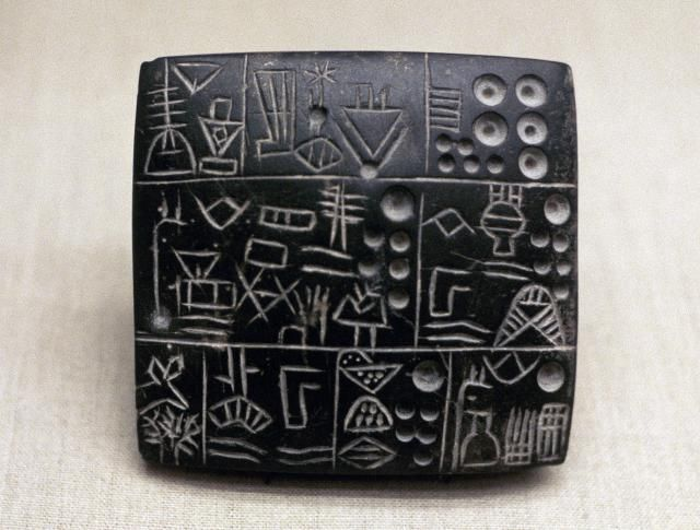The earliest form of writing on our planet, called proto-cuneiform, was invented in Mesopotamia during the Late Uruk period, about 3200 BC. Proto-cuneiform consisted of pictographs--simple drawings of the subjects of the documents--and early symbols representing those ideas, drawn or pressed into puffy clay tablets, which were then fired in a hearth or baked in the sun. Proto-cuneiform was not a written representation of the syntax of spoken language.