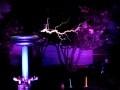 Twin Tesla coils play Mario Bros theme song.