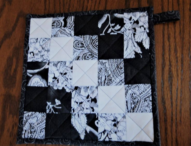 """Quilted patchwork insulated pot holder or hot pad or trivet 10"""" x 10"""" with hanging tab, black and white trivet by StephsQuilts on Etsy"""