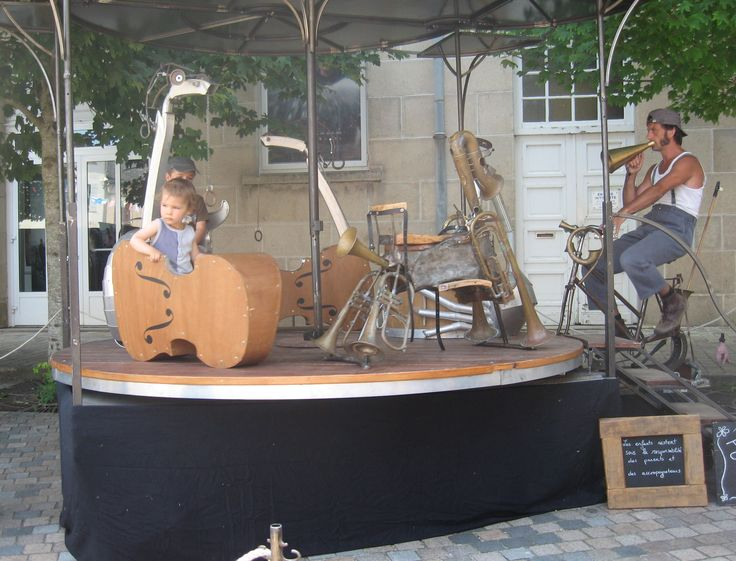 pedal power roundabout with the 'musical instrument rides' made from scrap materials and music from a vintage gramophone - bastile day uzerche