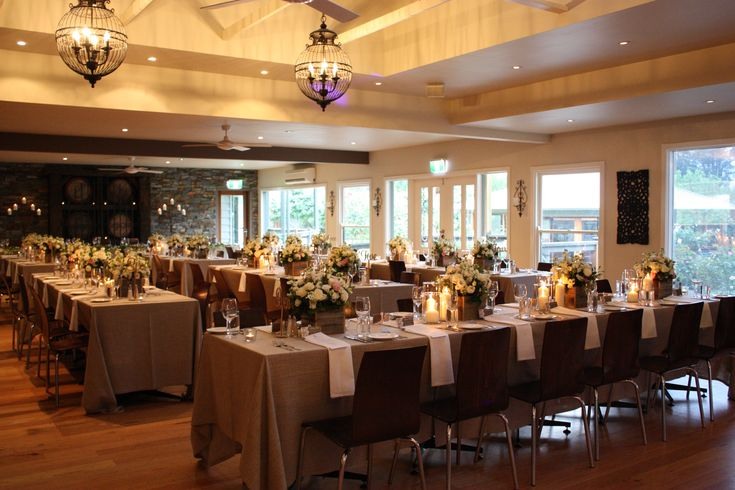 White napkins on charcoal tables look beautiful with long draping napkins!