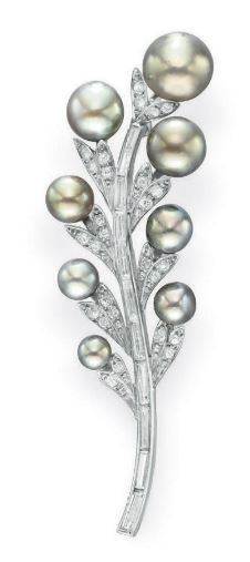 A PEARL AND DIAMOND BROOCH, BY TIFFANY & CO. Designed as a baguette-cut diamond branch, extending old European-cut diamond leaves with gray and greenish gray graduated pearl blossoms, measuring from approximately 9.85 to 4.80 mm, mounted in platinum, circa 1950. Signed Tiffany & Co.