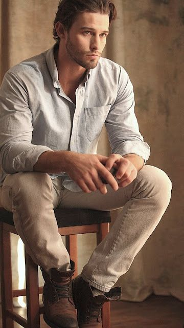 Rough spun clothing and possibly linen? Whatever, he makes it work. Kind if rustic looking.