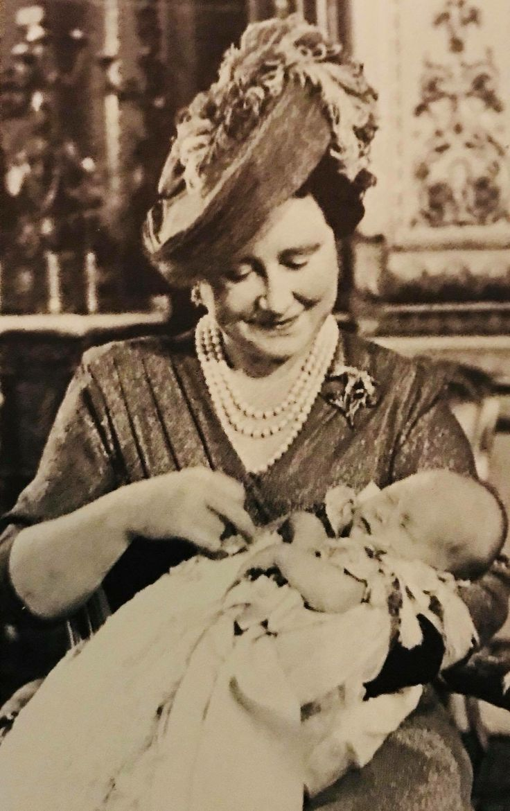 Prince Charles held by his grandmother at his christening