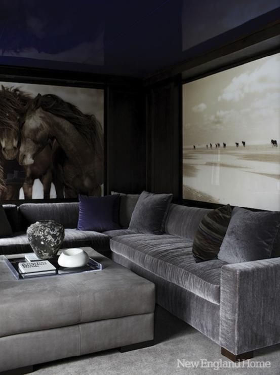 Fantastic media room with glossy blue lacquer walls & ceiling, horse art, steel gray velvet sectional sofa and  ottoman