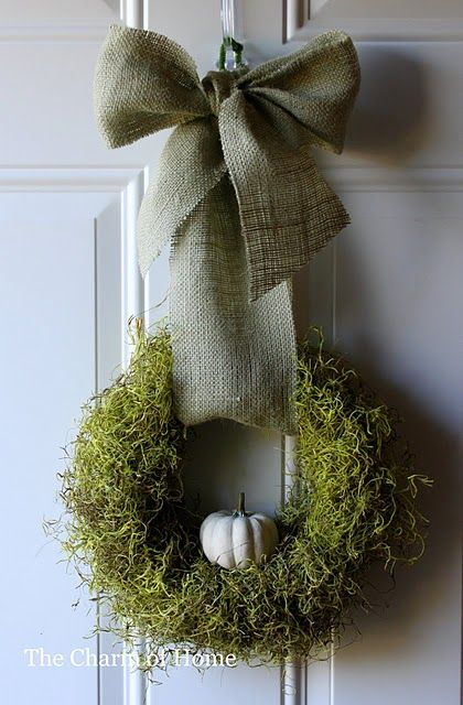 moss wreath, white pumpkin & burlap bow! so pretty.. I just like this whole thing and now want to make it.. not the bow for you... haha