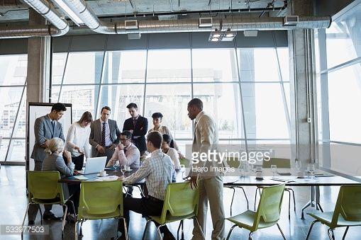 Stock Photo : Business people meeting around laptop in conference room