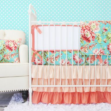 Caden Lane's boutique Coral Camila Ruffle baby bedding is perfect for a versatile and chic nursery!